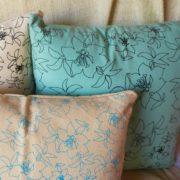 almohadones en turquesa